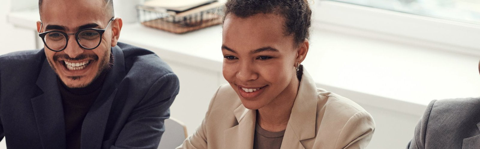 photo-of-three-people-smiling-while-having-a-meeting-3184338